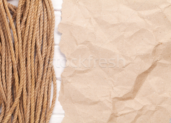Brown rumpled cardboard paper background with marine rope Stock photo © karandaev