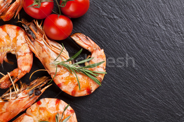 Grilled shrimps on stone plate Stock photo © karandaev