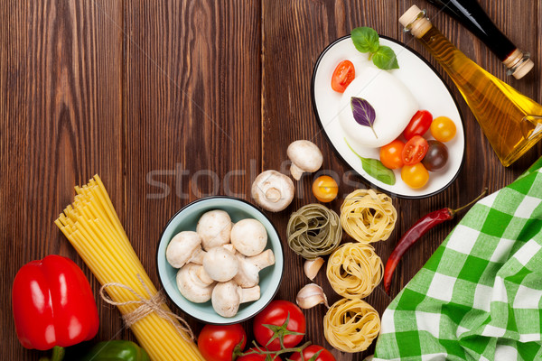 Mozzarella, tomatoes, basil and olive oil Stock photo © karandaev