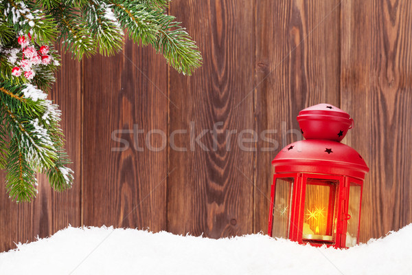 Christmas candle lantern and fir tree branch in snow Stock photo © karandaev