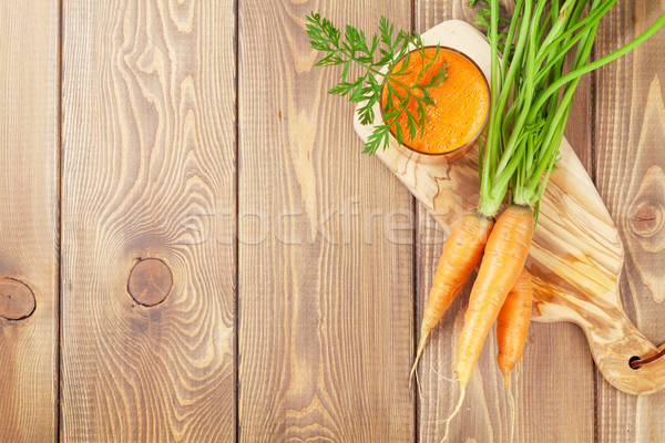 Fresh carrot juice smoothie and roots Stock photo © karandaev