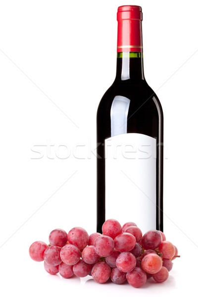 Red wine in bottle and grapes branch Stock photo © karandaev