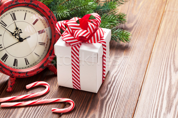 Stock photo: Christmas alarm clock, gift box and fir tree branch