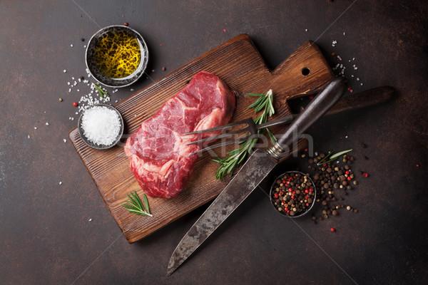 Raw ribeye beef steak cooking with ingredients Stock photo © karandaev