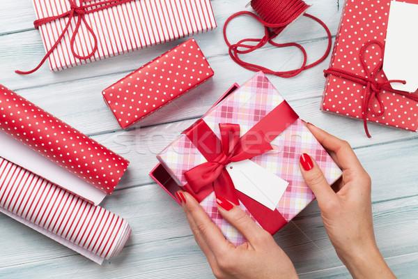 Female wrapping christmas gifts Stock photo © karandaev