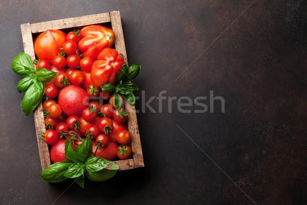 Fresh garden tomatoes and basil Stock photo © karandaev