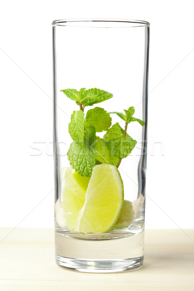 Mojito mix: lime, mint in glass on wood table Stock photo © karandaev
