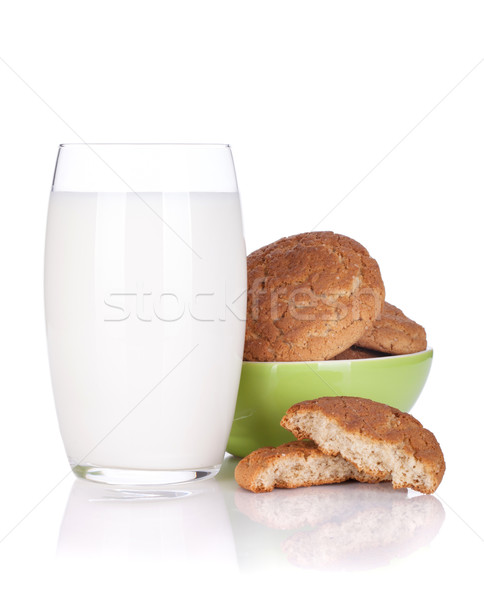Glass of milk and cookies bowl Stock photo © karandaev