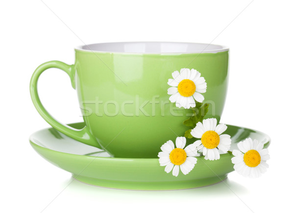 Green tea cup with camomiles Stock photo © karandaev