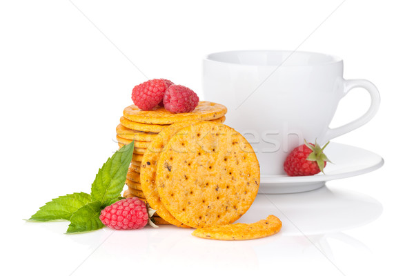 Stack of crackers with mint, berries and cup of drink Stock photo © karandaev
