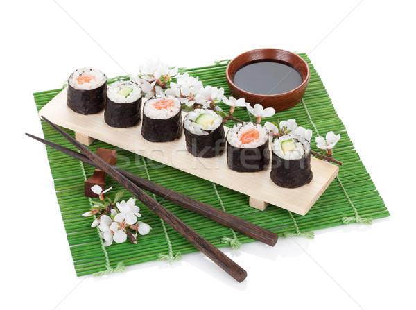 Sushi set with fresh sakura branch Stock photo © karandaev