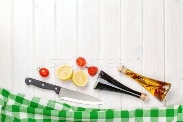 Cooking with tomatoes, lemons and condiments Stock photo © karandaev