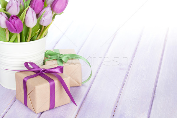 Purple tulip bouquet and gift box on wooden table Stock photo © karandaev