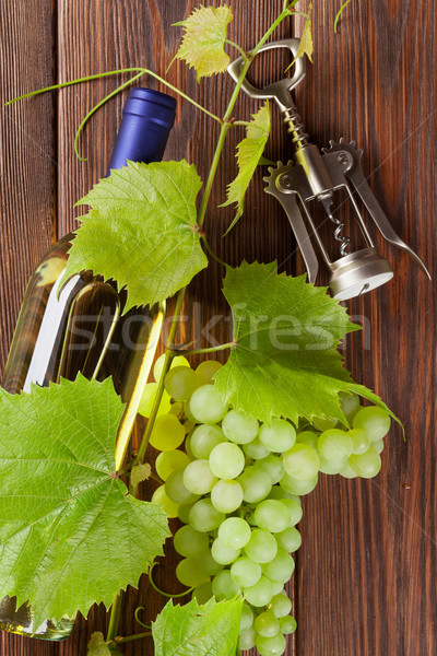 Bunch of grapes, white wine and corkscrew Stock photo © karandaev