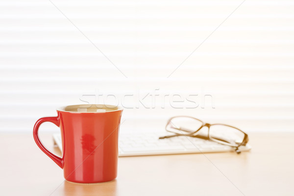Office workplace with coffee and pc Stock photo © karandaev
