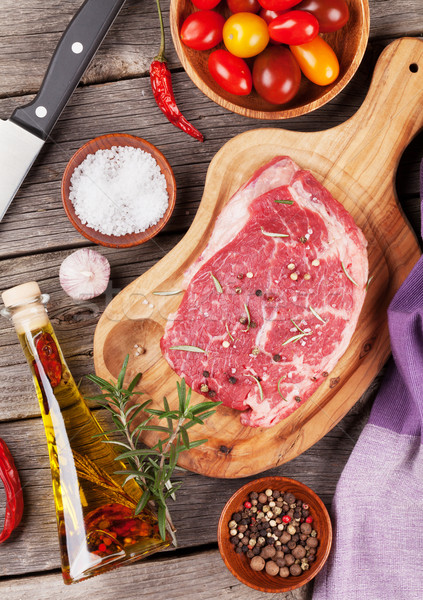 Stock photo: Raw beef steak with spices and herbs