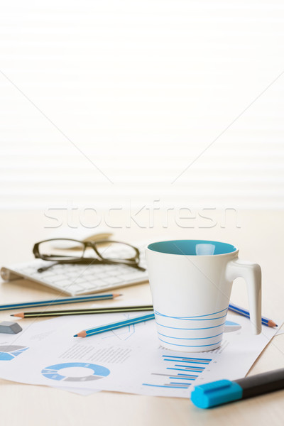 Office workplace with supplies and reports Stock photo © karandaev