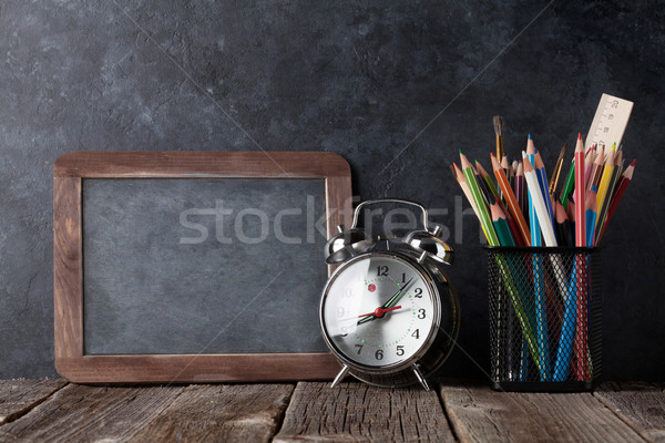 Alarm clock, supplies and chalk board Stock photo © karandaev