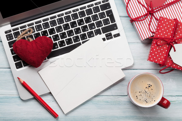 Working on laptop and wrapping gifts Stock photo © karandaev