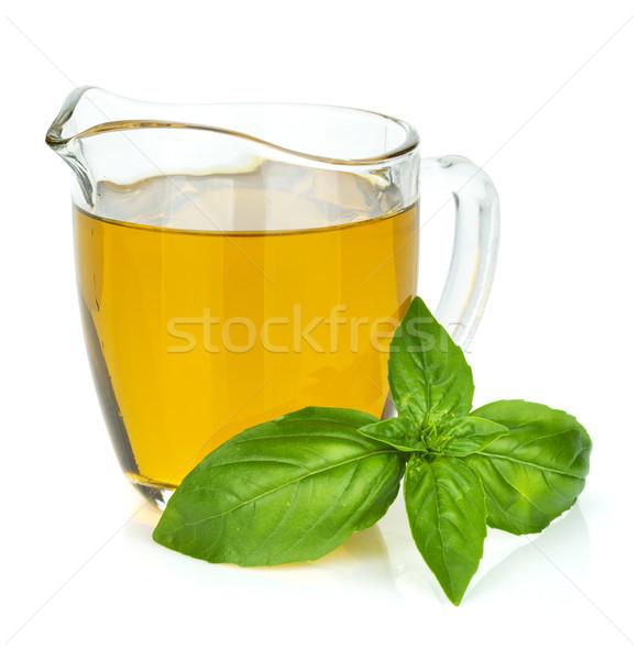 Olive oil and basil leaves Stock photo © karandaev