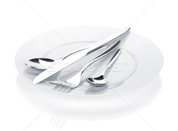 Silverware or flatware set of fork, spoons and knife over plates Stock photo © karandaev