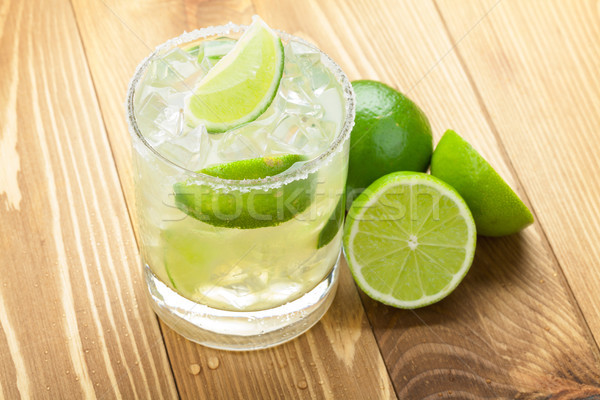 Classic margarita cocktail with lime and salty rim Stock photo © karandaev