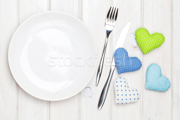 Stock photo: Empty plate, silverware and valentines day toy hearts