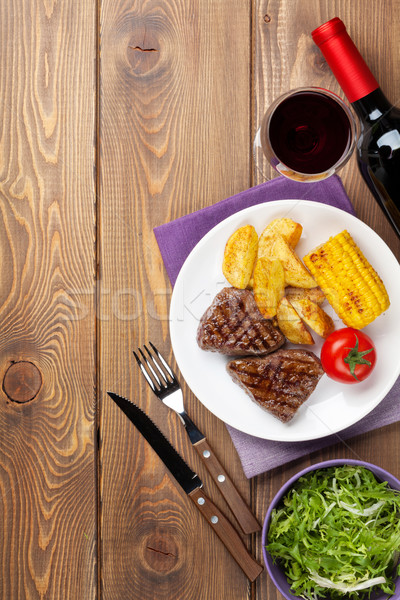 Steak with grilled potato, corn, salad and red wine Stock photo © karandaev