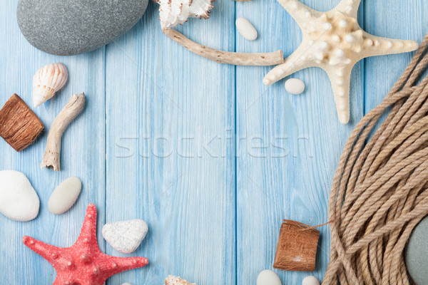Sea vacation background with star fish and marine rope Stock photo © karandaev