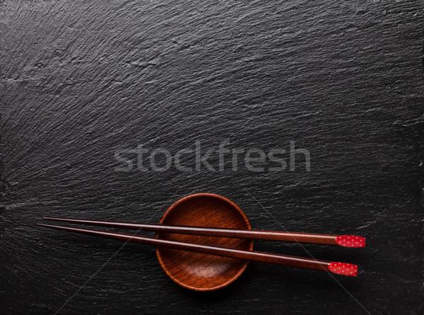 Japán szusi evőpálcikák szójaszósz tál fekete Stock fotó © karandaev