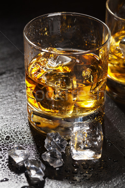 Glasses of whiskey with ice Stock photo © karandaev