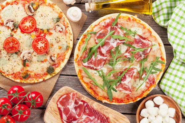 Pizza prosciutto domates mantar mozzarella ahşap masa Stok fotoğraf © karandaev