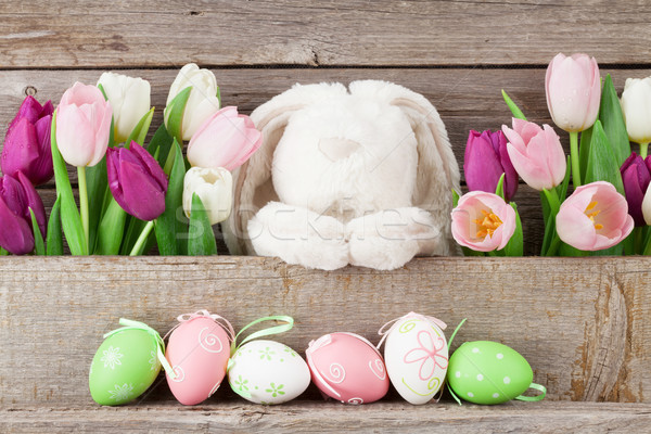 Easter eggs, rabbit toy and colorful tulips Stock photo © karandaev