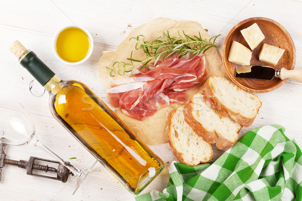 Prosciutto, wine, olives, parmesan and olive oil Stock photo © karandaev