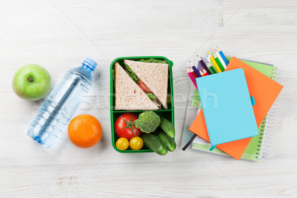 Lunch box and school supplies Stock photo © karandaev