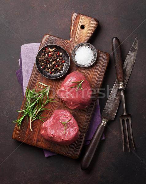 Surowy filet stek gotowania kamień tabeli Zdjęcia stock © karandaev