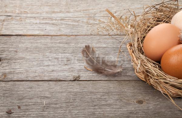 Jaj gniazdo drewniany stół kopia przestrzeń Wielkanoc wiosną Zdjęcia stock © karandaev
