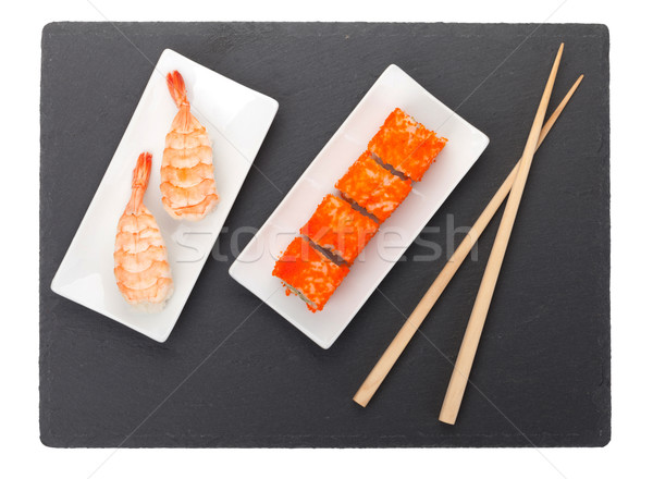 Sushi maki gamberetti nero pietra bacchette Foto d'archivio © karandaev