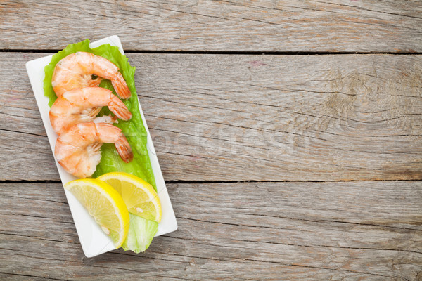 Cooked shrimps with lemon and salad leaves Stock photo © karandaev