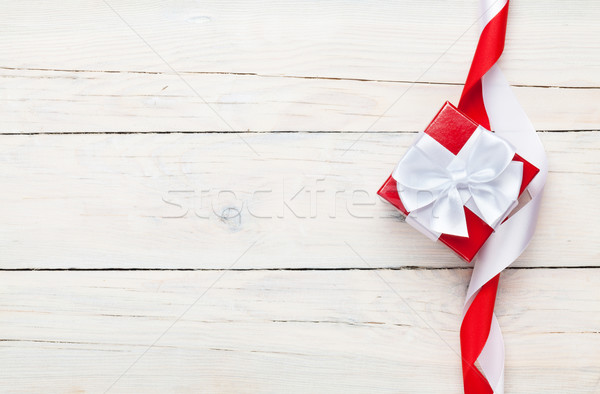 Valentines day background with gift box over white wooden table Stock photo © karandaev