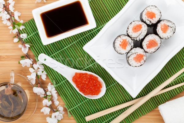 Red caviar, sushi set, sakura branch and green tea Stock photo © karandaev