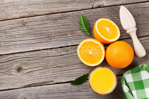 Fresh ripe oranges and juice Stock photo © karandaev