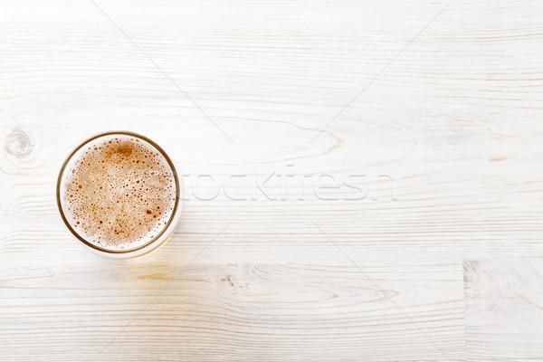 Beer mug on wooden table Stock photo © karandaev