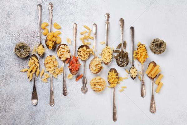 Various pasta on spoons Stock photo © karandaev