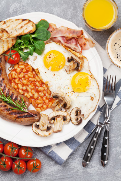 English breakfast. Fried eggs, sausages, bacon Stock photo © karandaev