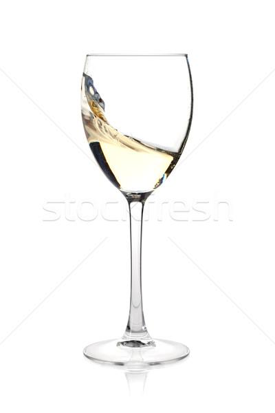 Splashing white wine in a glass Stock photo © karandaev