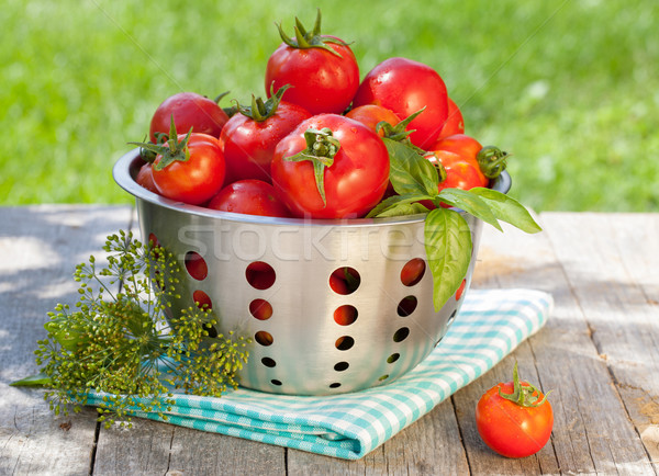 Fresh ripe tomatoes in colander Stock photo © karandaev
