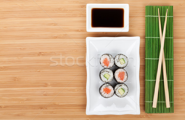 Sushis baguettes sauce de soja bambou table Photo stock © karandaev