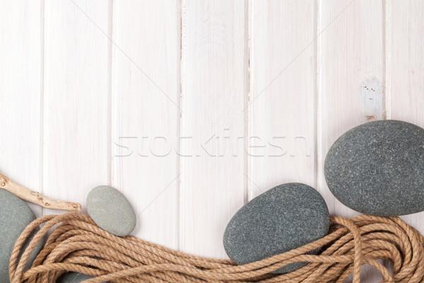 Wooden background with marine rope and sea stones Stock photo © karandaev