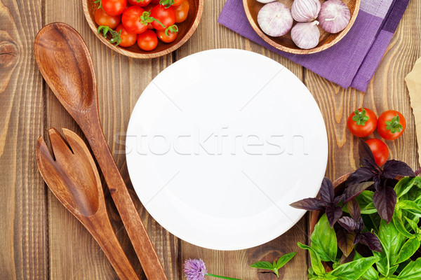 Fresh farmers tomatoes and basil with kitchen utensils Stock photo © karandaev